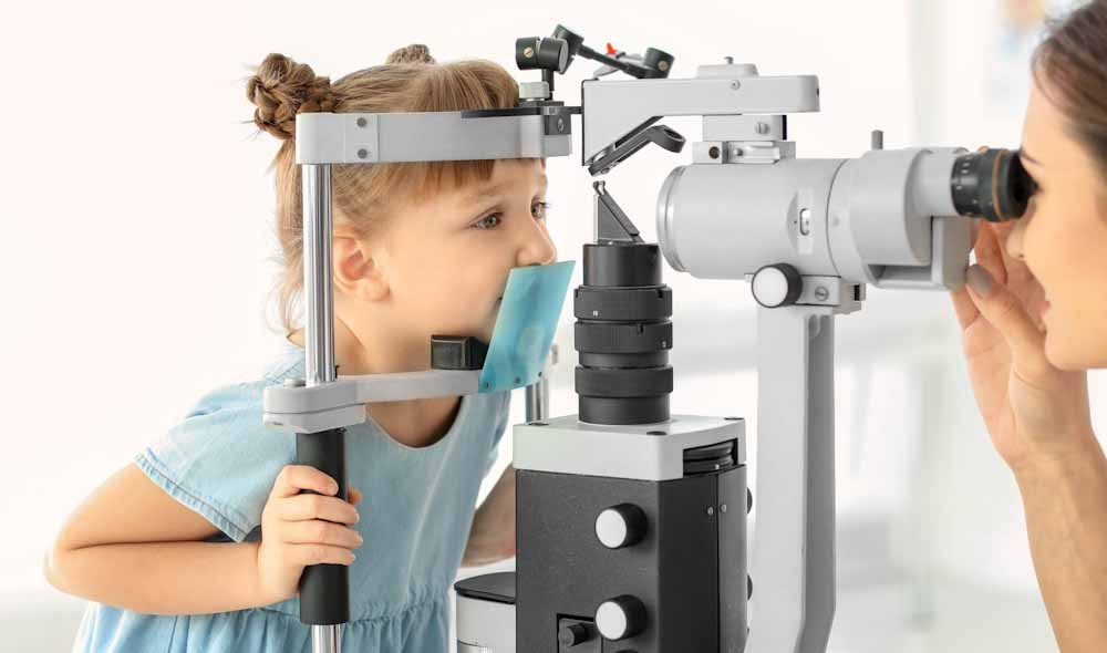 Cute little child at ophthalmologist's office